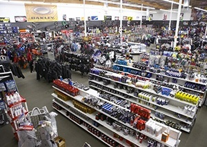 The dealership showroom features aisles of parts.