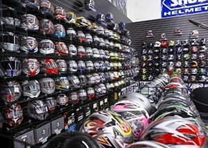 Rows of helmets line the walls of the dealership showroom.