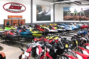 A row of red and white motorcycles line the showroom floor.