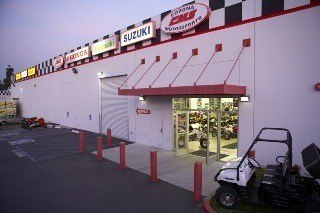 Corona Motorsport's Building Exterior features a racing checkered design around the roofline.